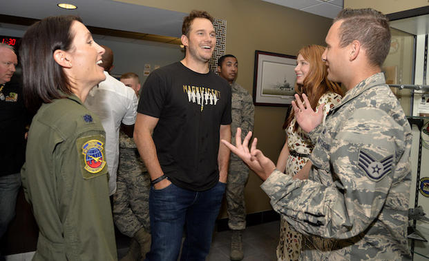 The Magnificent 7 movie actors Chris Pratt (center) and Haley Bennett (2nd,right) share a laugh with USAF Lt. Col. Jannell Macaulay (left) and an airman prior to a USO-sponsored film premiere at Joint Base McGuire-Dix-Lakehurst, New Jersey, September 18, 2016. The cast members and director toured the flightline, greeted service members and met with military families to extend their appreciation for their service. USO Photo by Mike Theiler