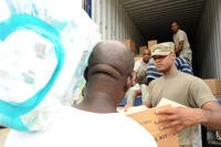 St. Thomas, U.S. Virgin Islands, US--Volunteers, as well as U.S. Virgin Island National Guardsmen, help to distribute supplies to local residents at the Omar Brown Sr. fire station on October 10, 2017. (Photo by Jocelyn Augustino/FEMA)