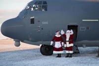 Mr. and Mrs. Santa Claus, travelling with Operation Santa Claus, de-board an HC-130J Combat King II aircraft from the 211th Rescue Squadron, Alaska Air National Guard, after landing in St. Michael, Alaska, Dec. 5, 2017. (U.S. Army National Guard/Marisa Lindsay)