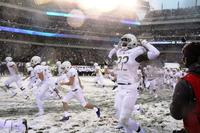 Army defensive back Ke'Shaun Wells flexes as he runs onto the field before the 118th Army-Navy Game, Dec. 9, 2017, at Lincoln Financial Field in Philadelphia.  (Photo by Steve Whitman/Military.com)