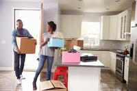 couple with moving boxes in kitchen