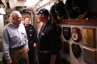 Secretary of the Navy Richard V. Spencer greets Lt. j.g. Keelen Collins, the navigator aboard the Arleigh Burke-class guided-missile destroyer USS Hopper (DDG 70), during a visit to the ship on Thanksgiving Day, Nov. 23, 2017. (U.S. Navy photo/Kristina Young)