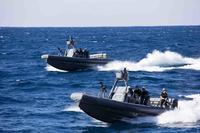 Two 11-meter Navy Special Warfare Rigid Hull Inflatable Boats transit to the amphibious transport dock ship USS New York to pick up Marines for a visit board search and seizure drill in the Atlantic Ocean on Nov. 25, 2017. Mass Communication Specialist 2nd Class Lyle Wilkie/Navy