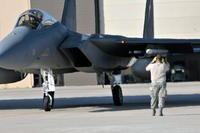 A U.S. Air Force Crew Chief prepares to launch an F-15 for a routine training mission at the 125th Fighter Wing, Jacksonville, Fla., on Aug. 19, 2014. (U.S. Air Force photo/Troy Anderson)