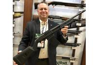 John Fink of Remington shows off the company's detachable mag shotgun. Photo by Hope Hodge Seck/Military.com
