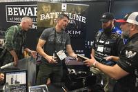 "Kris Paronto signs a copy of his book ""The Ranger Way"" at SHOT Show 2018 in Las Vegas. Hope Hodge Seck/Military.com"