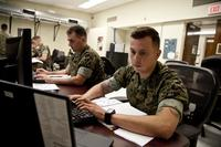 FILE -- U.S. Marines assigned to the Cyber Security Technician course, Marine Corps Communications-Electronics School, work on a assignment at Marine Corps Base Twentynine Palms, Calif., March 15, 2017. (U.S. Marine Corps/Lance Cpl. Jose Villalobosrocha)