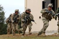 "Troopers from 1st Squadron ""Tiger,"" 3rd Cavalry Regiment, maneuver around buildings during an urban training exercise Dec. 7, 2017 on Fort Hood, Texas. (U.S. Army/Staff Sgt. Taresha Hill)"