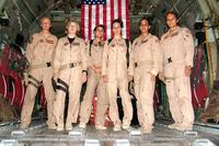 From left to right, Staff Sgt. Josie E. Harshe, flight engineer; Capt. Anita T. Mack, navigator; 1st Lt. Siobhan Couturier, pilot; Capt. Carol J. Mitchell, aircraft commander; and loadmasters Tech. Sgt. Sigrid M. Carrero-Perez and Senior Airman Ci Ci Alonzo, pause in the cargo bay of their C-130 for a group photo following their historic flight. (U.S. Air Force/ Tech. Sgt. Louis Vega)