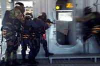 Students of the Ship's Reaction Force Advanced Class enter and secure the bridge during a shipboard force-protection simulation at the Center for Security Forces Pearl Harbor Learning. Simulations such as these educate and train for real-world situations. (U.S. Navy/Mass Communication Specialist 2nd Class Daniel Cleary)