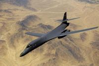 An Air Force B-1B Lancer aircraft moves out of position after receiving fuel from a KC-135R Stratotanker during a mission over Afghanistan. (U.S. Air Force/Master Sgt. Andy Dunaway)