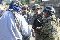 A combat advisor for the 2nd Battalion, 1st Security Forces Assistance Brigade shakes hands with a role player acting as an Afghan civilian to begin the process of settling the conflict in the simulated town of Batoor, Jan. 15, 2018, as part of rotation 18-03 at the Joint Readiness Training Center, at Fort Polk, La. (U.S. Army /Sgt. Ryan Tatum)