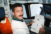 STS-106 Mission Specialist (MS) Daniel Burbank reads a checklist on the aft flight deck of Atlantis, Orbiter Vehicle (OV) 104, October 27, 2010. (Courtesy photo/NASA)