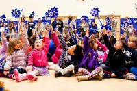 Children hold up pinwheels before the start of a Pinwheel for Prevention parade, during Military Child and Child Abuse Prevention Month last year at Joint Base Myer-Henderson Hall, Va. (US Army photo/Rachel Larue)