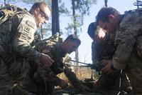 Soldiers assigned to 1st Battalion, 38th Cavalry Regiment, 1st Security Force Assistance Brigade build their communications system during a field training exercise Oct. 24, 2017, at Ft. Benning, Ga. (U.S. Army/Sgt. Arjenis Nunez)