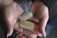 Joanna Mueller holds the identification tags of her uncle, U.S. Army Sgt. Floyd J.R. Jackson. Jackson, who was missing in action after the Battle of Chosin Reservoir, was assumed to be a prisoner of war. DNA evidence confirmed he died in a Korean POW camp around Dec. 12, 1950. (U.S. Army National Guard/Manda Walters/Released)
