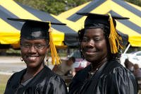 Mother and daughter Sandra and Nathenia Wells completed and associate of arts in general studies degrees and walked the stage at the Fort Bragg Colleges and Universities Graduation and Recognition Ceremony. (U.S. Army/Amber Avalona)