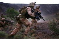 U.S. Marines maneuver toward an objective during a live-fire and movement exercise at D'Arta Plage, Djibouti on Nov. 3, 2014. Department of Defense photo