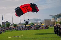 Sgt. 1st Class Aaron Figel, with the U.S. Army Special Operations Command parachute team, the Black Daggers, makes final adjustments for a tip-toe landing during a jump demonstration for National Airborne Day at the Airborne & Special Operations museum, in Fayetteville, N.C. in August 2014 (U.S. Army photo/Chuck Vickers)
