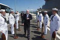 Sen. John S. McCain III is piped aboard during a visit to the Arleigh Burke-class guided-missile destroyer USS John S. McCain
