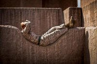 Marine Lance Cpl. Curtis E. Sledge relaxes on a rock wall before participating in a night raid on Marine Corps Base Hawaii, April 17, 2015. (U.S. Marine Corps photo by Lance Cpl. Aaron S. Patterson)