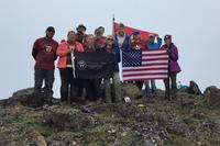 A group with the Travis Manion Foundation stands at the top of Gold Star Peak, Alaska. (Photo courtesy of Luke Bushatz)