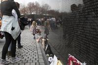 A young girl walks along the wall at the Vietnam War Memorial before a wreath laying ceremony in Washington, D.C., March 29, 2018. (U.S. Marine Corps/Cpl. Daisha R. Sosa)