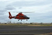 A Coast Guard MH-65 Dolphin helicopter aircrew takes off at Air Station Barbers Point, Hawaii, Aug. 25, 2018. (U.S. Coast Guard photo/Matthew West)