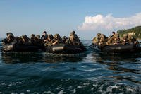 U.S. Marines assigned to Echo Company, 2nd Battalion, 5th Marine Regiment, conduct an amphibious raid during KAMANDAG 2 on Philippine Marine Corps base Gregorio Lim, Philippines, Oct. 8, 2018. (U.S. Marine Corps photo/Christian Ayers)