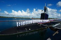 The crew of USS Indiana (SSN 789) salutes after bringing the ship to life during the commissioning ceremony, Sept. 29, 2018. Indiana is the U.S. Navy's 16th Virginia-class fast-attack submarine and the third ship named for the State of Indiana. (U.S. Navy photo/Leah Stiles)