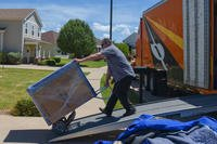 A civilian contractor unloads boxes of home goods at Dyess Air Force Base, Texas, Aug. 29, 2018. (U.S. Air Force photo/Kylee Thomas)