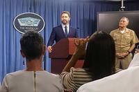 "Actor Gerard Butler speaks to reporters at the Pentagon on Oct. 15, 2016, promoting his new movie, ""Hunter Killer."" Navy Vice Adm. Fritz Roegge stands to his right. Photo by Oriana Pawlyk/Military.com"