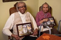 Ida Jones-Dickens, left, and Elizabeth Jones-Ohree hold collages presented to them by the Defense POW/MIA Accounting Agency (DPAA) at Elizabeth's home in Rocky Mount, North Carolina, Nov. 15, 2018. (U.S. Air Force photo by Staff Sgt. Apryl Hall)