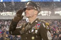 Sergeant Major of the Army Dan Dailey, wearing the Army's proposed 'Pink and Green' daily service uniform, salutes the Anthem pre-kickoff during the Army-Navy game at Lincoln Financial Field in Philadelphia, Pennsylvania Dec. 9, 2017. (U.S. Army/Ronald Lee)