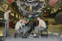 185th Air Refueling Wing jet engine mechanics remove a transfer gear box from a General Electric F-108 engine on a U.S. Air Force KC-135 at the Iowa Air National Guard aircraft maintenance facility in Sioux City, Iowa on January 17, 2019. (U.S. Air National Guard/Senior Master Sgt. Vincent De Groot)