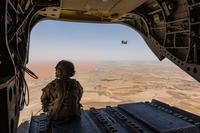 A U.S. Army Reserve CH-47 Chinook helicopter pilot deployed with Task Force Warhawk, 16th Combat Aviation Brigade, 7th Infantry Division scans below over the Registan Desert in Helmand Province, Afghanistan, June 21, 2017. The Warhawks provide aviation support to U.S. Forces Afghanistan as part of Operation Freedom's Sentinel. (Brian Harris/U.S. Army)