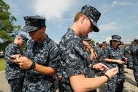 Navy members use cell phones