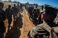 Marines and Sailors with Combat Logistics Battalion 5, Combat Logistics Regiment 1, 1st Marine Logistics Group participate in a seven mile conditioning hike on Camp Pendleton, Calif., June 27, 2017. (U.S. Marine Corps/Lance Cpl. Adam Dublinske)