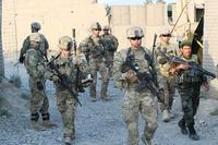 FILE -- Soldiers from the 3rd Infantry Division leave an Afghan National Army outpost during an ANA led patrol to meet the Afghan citizens at a nearby village, Aug. 21, 2013, in Logar province, Afghanistan. (U.S. Army/Staff Sgt. Elvis Umanzor)