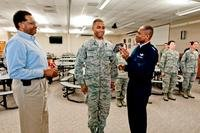 U.S. Air Force Gen. Darren W. McDew, the commander of Air Mobility Command, awards the rank of senior master sergeant to Master Sgt. Brian J. Lovingood, services specialist with the 182nd Force Support Squadron. (U.S. Air Force/Scott Thompson)