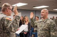 Brig. Gen. David Anderson (left), commander of the North Dakota Army National Guard, administers the oath of office to newly-promoted Maj. Dan Murphy during his promotion ceremony. (U.S. National Guard/SSgt Brett Miller)