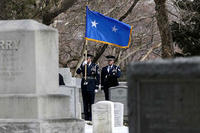 Joint Base McGuire-Dix-Lakehurst Honor Guard members Len Werner, left, and Jared Lacovara stand during a burial service at the West Point Cemetery on Friday, March 22, 2013, in West Point, N.Y.