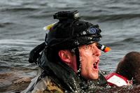 A U.S. Air Force airman from the 23rd Special Tactics Squadron swims to a boat after rescuing a simulated crash victim at Whynnehaven Beach, Fla., April 9, 2013. (U.S. Air Force/Airman 1st Class Christopher Callaway)
