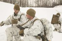Cpl. Thomas Powers explains the next movement to Cpl. Greggory Williams while conducting a routine patrol during the final exercise of cold-weather training aboard Porsangmoen, Norway, Feb. 16-20, 2016. (Photo By: Cpl. Immanuel Johnson)