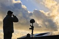 FILE - A Staff Sgt. salutes a fallen warrior memorial May 19, 2017, Andersen Air Force Base, Guam. (U.S Air Force/Airman 1st Class Christopher Quail)
