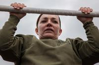 Major Misty Posey demonstrates proper form for pull-ups to Marines at Marine Corps Base Quantico, Virginia, Feb. 19, 2016. (Sgt. Dylan Bowye/U.S. Marine Corps)