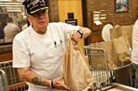 Don Magers, retired Marine, bags groceries at the Whiteman Air Force Base, Missouri commissary. (Photo: U.S. Air Force/Senior Airman Daniel Phelps.)
