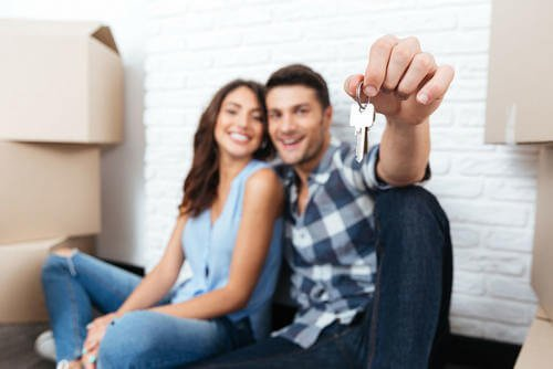 A couple with house keys