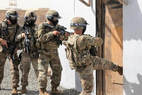 Soldiers of Alpha Company, 1st Battalion, 6th Infantry Regiment conduct a breaching operation, at the U.S. Army Central Command Readiness Training Center located at Camp Buehring, Kuwait, March 20, 2018. (U.S. Army/Sgt. 1st Class Charles Highland)
