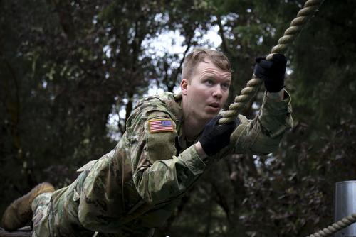 A Soldier assigned to the 189th Combined Arms Training Brigade maneuvers through an obstacle course during the Brigade's Best Captain Competition on Joint Base Lewis-McChord, Wash., April 4, 2018. (U.S. Army/SSG Eliverto V Larios)